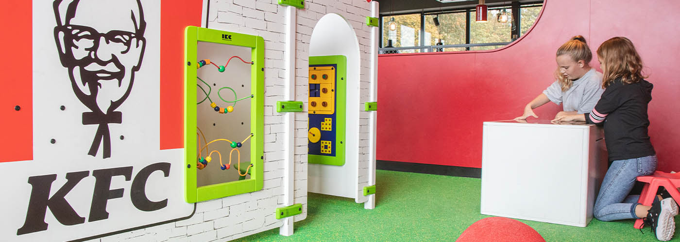 this image shows a kids corner with wall games in KFC restaurant